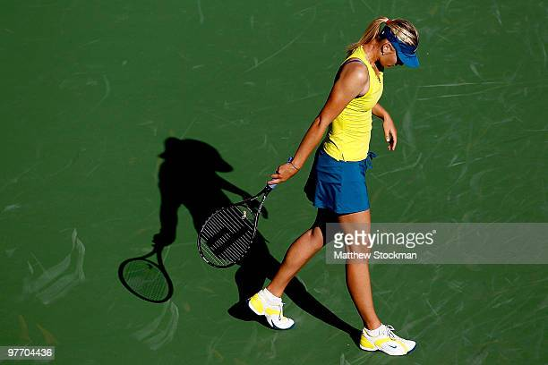 Maria Sharapova of Russia walks back to the baseline between points against Jie Zheng of China during the BNP Paribas Open on March 14 2010 in Indian...