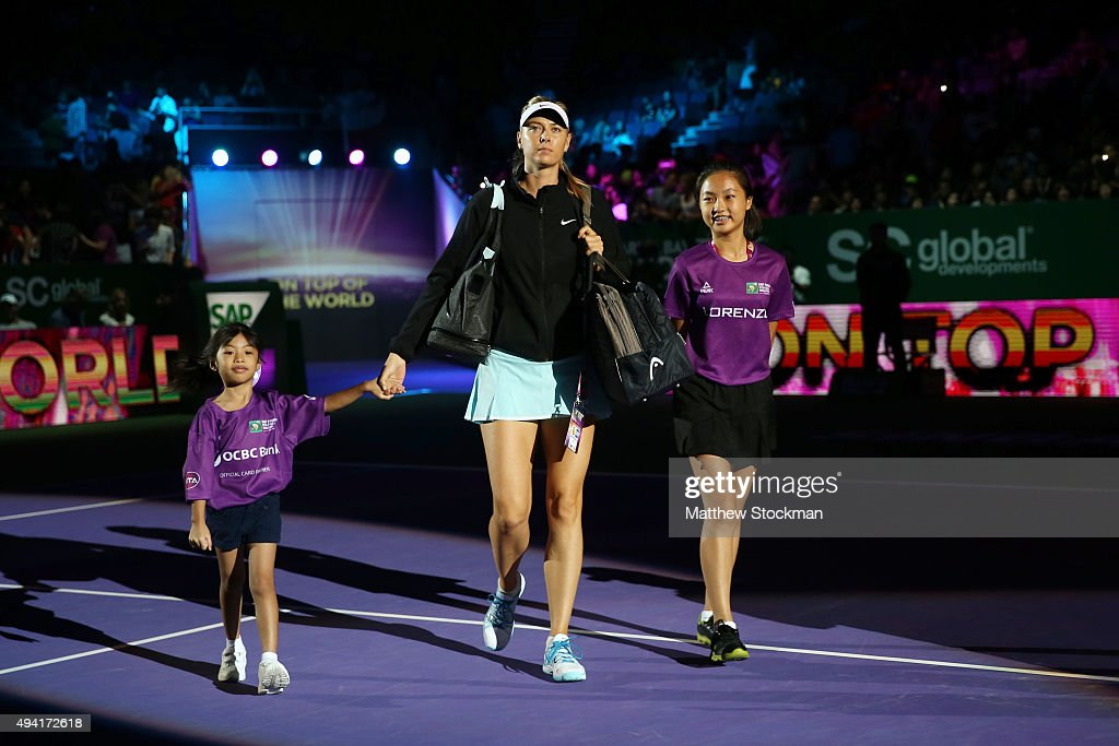 Maria Sharapova of Russia walks out on the court prior to her round robin match againt Agnieszka Radwanska during the BNP Paribas WTA Finals at Singapore Sports Hub on October 25, 2015 in Singapore.