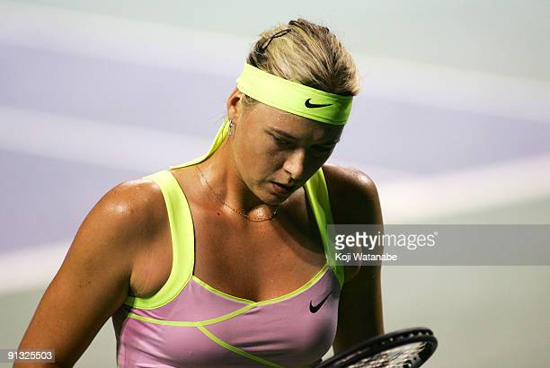 Maria Sharapova of Russia walks to the back of the court in her match against Agnieszka Radwanska of Poland during day six of the Toray Pan Pacific...