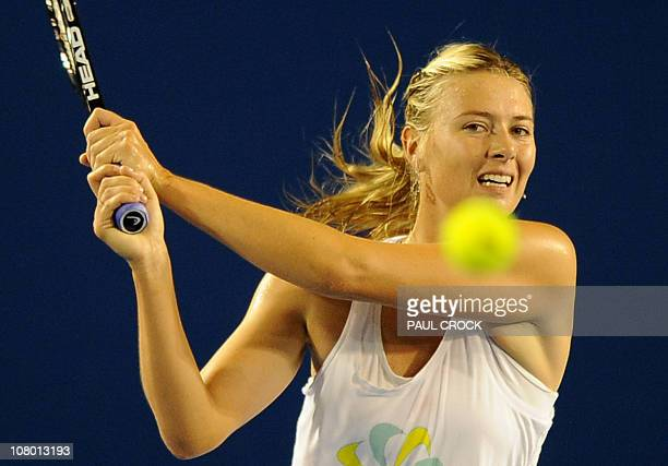 Maria Sharapova of Russia watches a return during a practice session for the upcoming Australian Open tennis tournament in Melbourne on January 13...