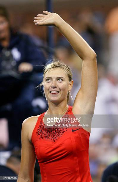 Maria Sharapova of Russia waves to fans after winning her 2007 US Open match against Casey Dellacqua of Australia in Arthur Ashe Stadium at the...