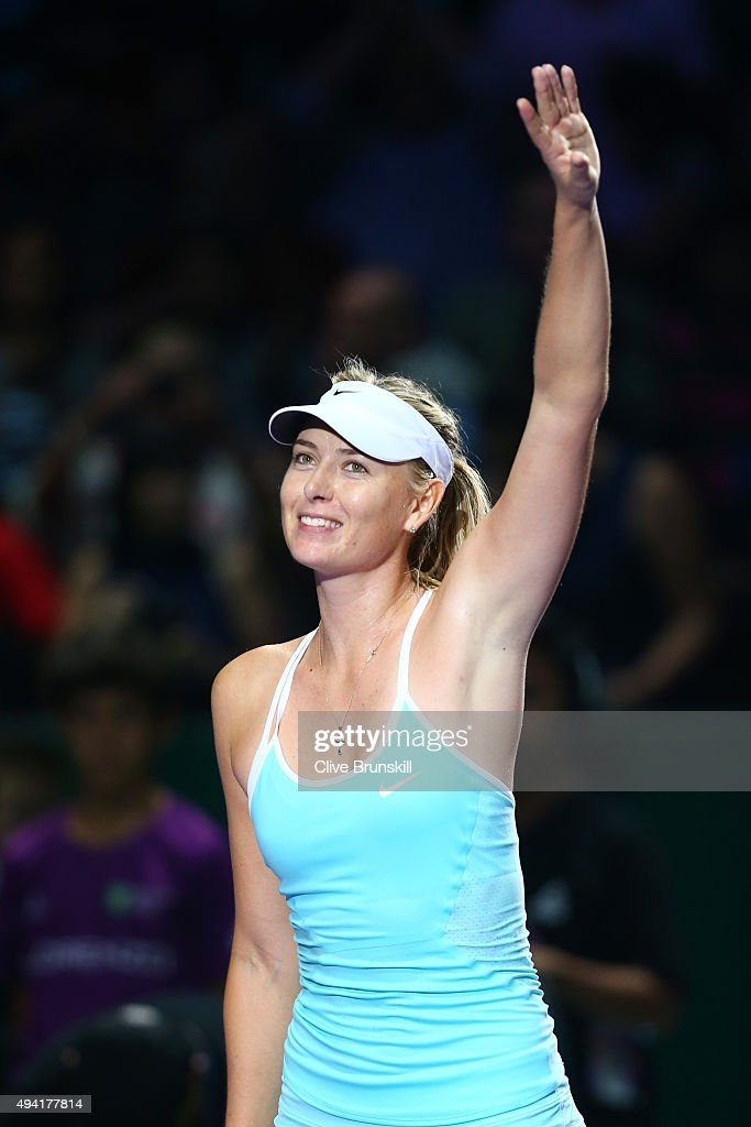 Maria Sharapova of Russia waves to the crowd after a three set victory againt Agnieszka Radwanska of Poland in a round robin match during the BNP Paribas WTA Finals at Singapore Sports Hub on October 25, 2015 in Singapore.