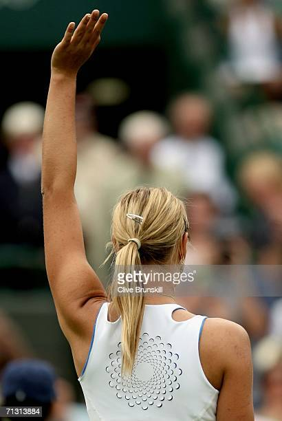 Maria Sharapova of Russia waves to the crowd after defeating Anna Smashnova of Israel during day three of the Wimbledon Lawn Tennis Championships at...
