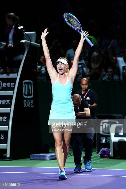 Maria Sharapova of Russia waves to the crowd after defeating Simona Halep of Romania in a round robin match during the BNP Paribas WTA Finals at...