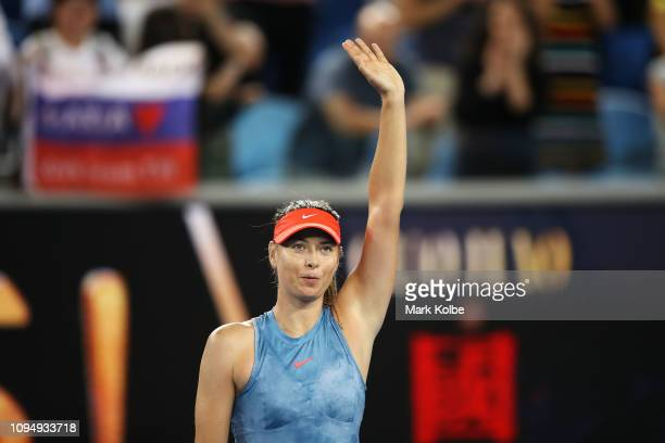 Maria Sharapova of Russia waves to the crowd after victory in her second round women's singles match against Rebecca Peterson of Sweden during day...