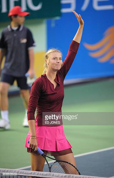 Maria Sharapova of Russia waves to the crowd after winning the women's singles final against Caroline Wozniacki of Poland at the Hong Kong Tennis...