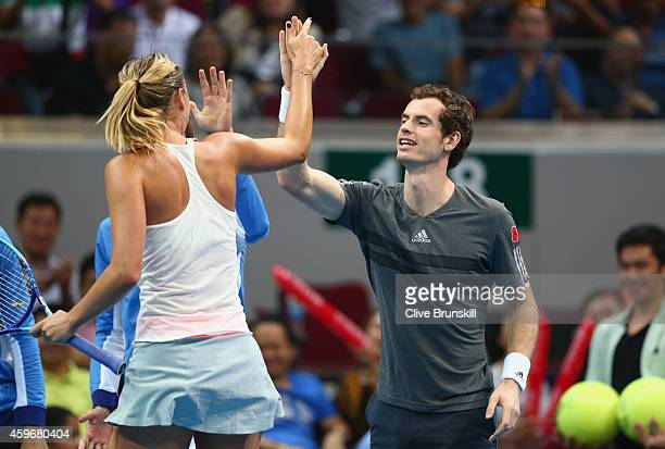 Maria Sharapova of the Manila Mavericks celebrates with team mate Andy Murray after victory against Kristina Mladenovic of the UAE Royals during the...