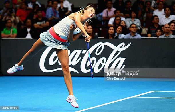 Maria Sharapova of the Manila Mavericks serves against Ana Ivanovic of the Indian Aces during the CocaCola International Premier Tennis League at the...