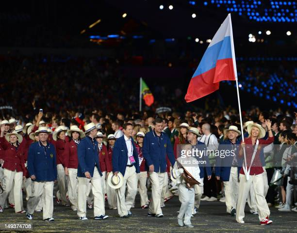 Maria Sharapova of the Russia Olympic tennis team carries her country's flag during the Opening Ceremony of the London 2012 Olympic Games at the...