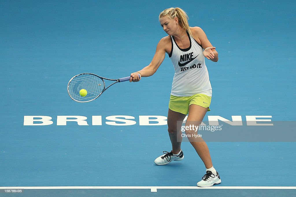 Maria Sharapova plays a forehand during a practice session at Pat Rafter Arena on December 29, 2012 in Brisbane, Australia.
