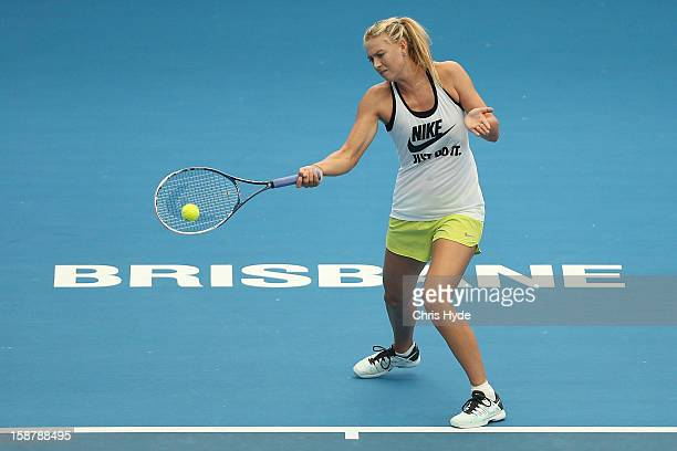 Maria Sharapova plays a forehand during a practice session at Pat Rafter Arena on December 29 2012 in Brisbane Australia