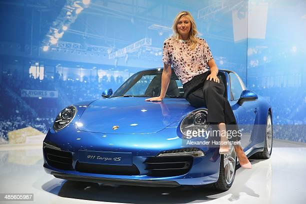 Maria Sharapova Porsche's global brand ambassador poses with the Porsche Tennis Grand Prix 2014 winners car the Porsche targa 4s at the Porsche Arena...
