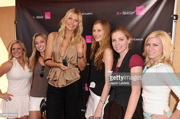 Maria Sharapova poses with contest winners the launch of the Sony Ericsson Equinox phone on October 31 2009 in Canoga Park California