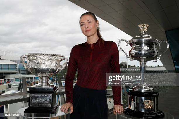 Maria Sharapova poses with the Australian Open trophies ahead of the 2020 Australian Open at Melbourne Park on January 12 2020 in Melbourne Australia