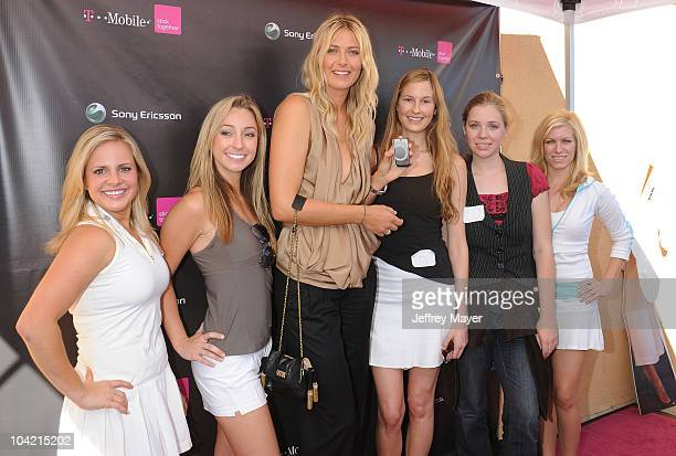 Maria Sharapova poses with the LookaLike contestants at the launch of the Sony Ericsson Equinox Phone at the TMobile Store on October 31 2009 in...