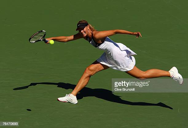 Maria Sharapova reaches for a return shot a shot against Agnieszka Radwanska of Poland during day six of the 2007 US Open at the Billie Jean King...