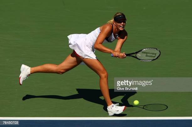 Maria Sharapova returns a shot against Agnieszka Radwanska of Poland during day six of the 2007 US Open at the Billie Jean King National Tennis...