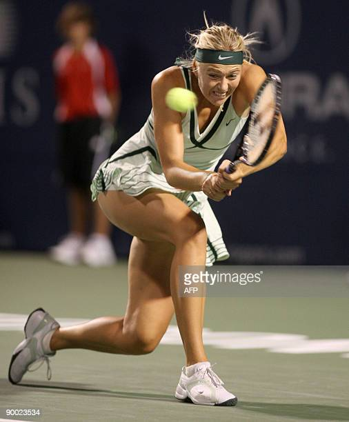 Maria Sharapova returns a shot during her semi final victory over Alisa Kleybanova at the Rogers Cup August 22 2009 in Toronto Ontario Canada AFP...