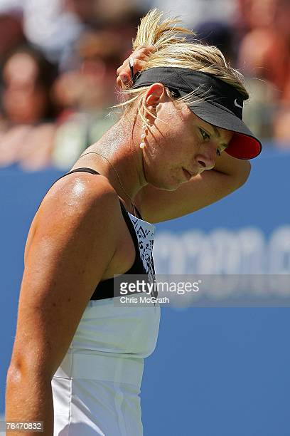 Maria Sharapova returns reacts to a point against Agnieszka Radwanska of Poland during day six of the 2007 US Open at the Billie Jean King National...