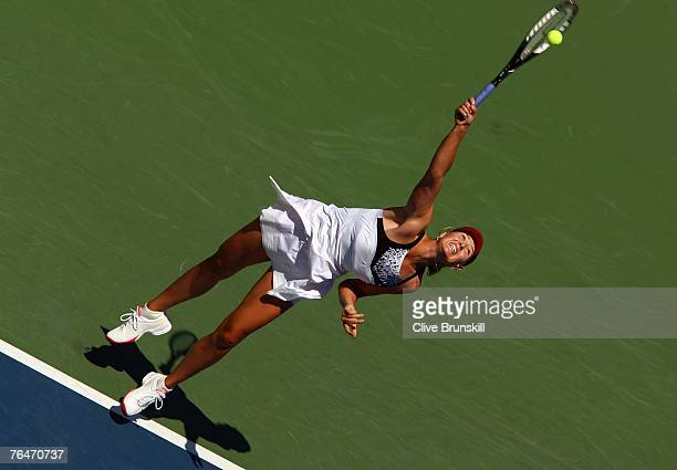 Maria Sharapova serves against Agnieszka Radwanska of Poland during day six of the 2007 US Open at the Billie Jean King National Tennis Center on...