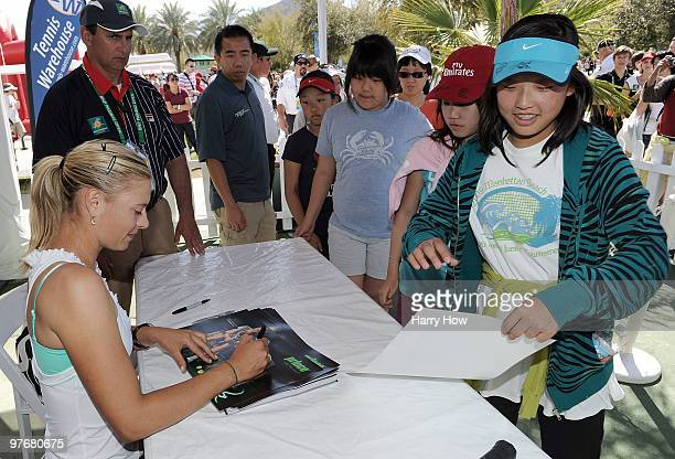 Maria Sharapova signs autographs during the BNP Paribas Open at the Indian Wells Tennis Garden on March 13 2010 in Indian Wells California