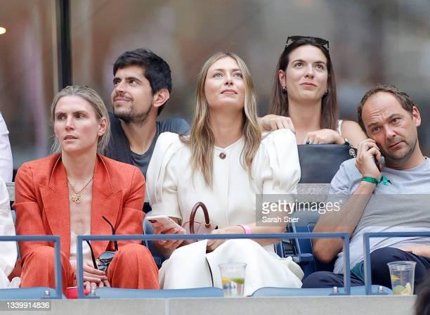 Maria Sharapova, tennis player, watches the Men's Singles final match between Daniil Medvedev of Russia and Novak Djokovic of Serbia on Day Fourteen...