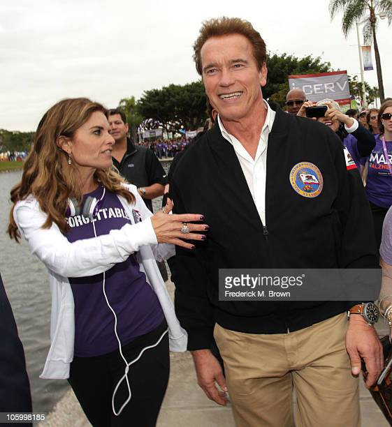 Maria Shriver and Governor of California Arnold Schwarzenegger walk during Maria Shriver's Women's Conference at the Long Beach Convention Center on...