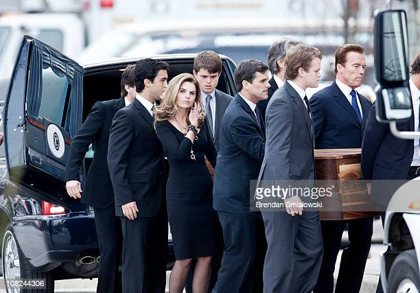 Maria Shriver , Arnold Schwarzenegger and other loved ones carry the casket of Sargent Shriver into at Our Lady of Mercy Catholic Church January 22,...