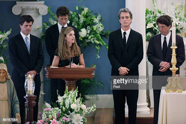 Maria Shriver speaks as Tim Shriver Anthony Shriver Bobby Shriver and Mark Shriver listen during the funeral of their mother Eunice Kennedy Shriver...