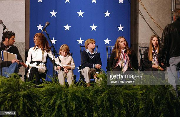 Maria Shriver wife of Governor-Elect Arnold Schwarzenegger talks with a unidentified man as she sits with her children Christopher 6, Patrick 10,...
