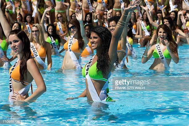 Maria Silvana Belli Miss Argentina 2008 and Tracey Nicolaas Miss Aruba 2008 wave to the cameras poolside at Diamond Bay Resort and Golf in their BSC...