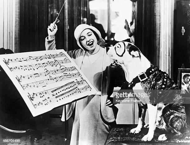 Maria Sorrano a famous opera singer from the Teatro Lirico in Milan is giving singing lessons to her dog 'Pete' on August 22 1932 in New York City