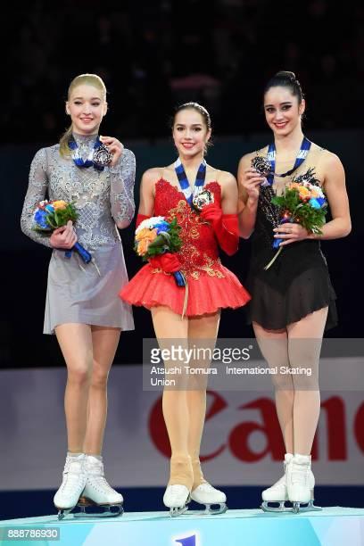 Maria Sotskova of Russia Alina Zagitova of Russia and Kaetlyn Osmond of Canada pose on the podium after the ladies free skating during the ISU Junior...