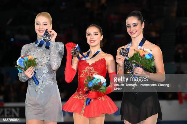 Maria Sotskova of Russia Alina Zagitova of Russia and Kaetlyn Osmond of Canada pose with medals after the ladies free skating during the ISU Junior...