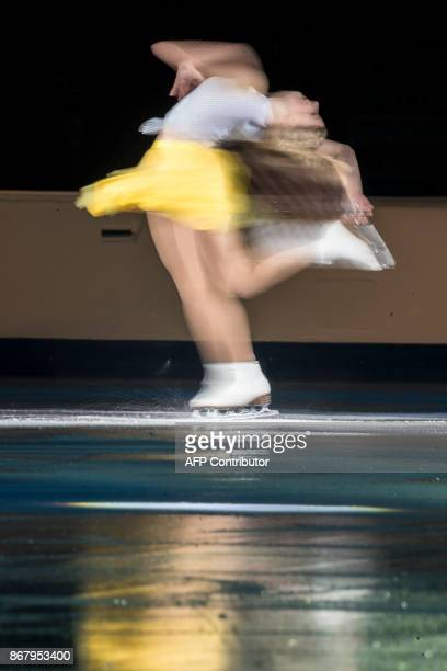 Maria Sotskova of Russia spins during a slow exposure as she skates her exhibition program at the ISU Grand Prix of Figure Skating's Skate Canada...