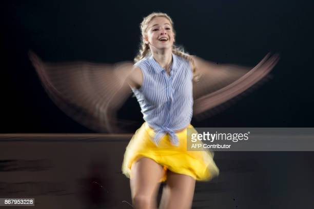 Maria Sotskova of Russia waves her arms during a slow exposure as she skates her exhibition program at the ISU Grand Prix of Figure Skating's Skate...