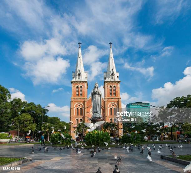 Maria statue in Notre Dame cathedral with blue sky background, Ho Chi Minh City, southern Vietnam