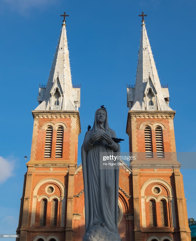 Maria statue in Notre Dame cathedral with blue sky background, Ho Chi Minh City, southern Vietnam : Stock Photo