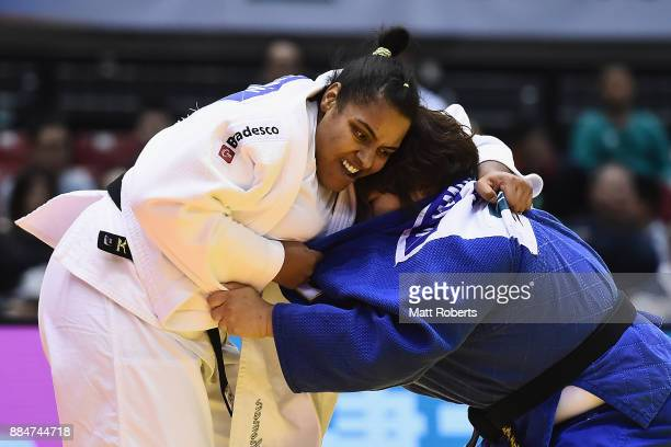 Maria Suelen Altheman of Brazil competes against Nami Inamori of Japan in the Women's 78kg Bronze Final during day two of the Judo Grand Slam Tokyo...