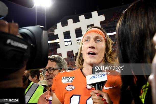 Maria Taylor of ESPN interviews quarterback Trevor Lawrence of the Clemson Tigers on the field after the Tigers' victory over the Georgia Tech Yellow...