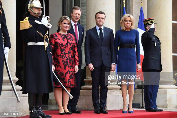 Maria Teresa Grand Duchess of Luxembourg Henri Grand Duke of Luxembourg French President Emmanuel Macron and Brigitte Macron pose in the courtyard of...