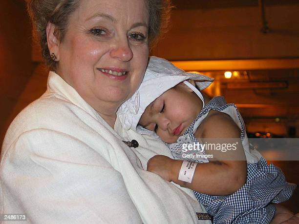 Maria Teresa Quiej Alvarez one of the separated Guatemalan twins cuddles with 'Healing the Children's' Cris Embleton as they prepare to leave Mattel...