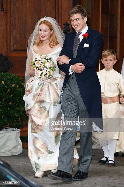 Maria Theresia von Thurn und Taxis and Hugo Wilson leave the church after the Wedding Ceremony on September 13 2014 in Tutzing Germany
