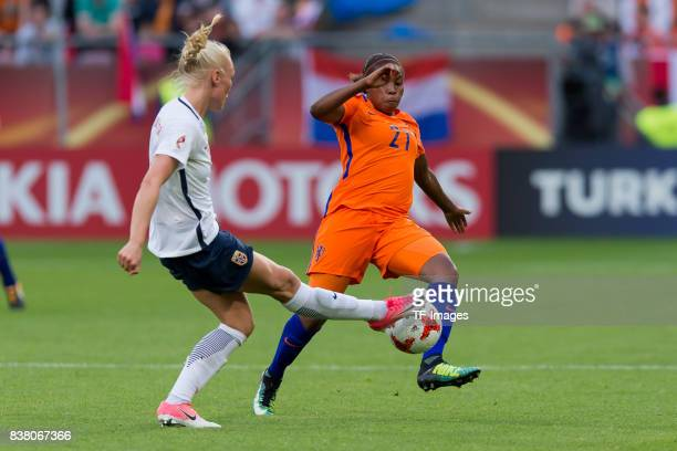 Maria Thorisdottir of Norway and Lineth Beerensteyn of the Netherlands battle for the ball during their Group A match between Netherlands and Norway...