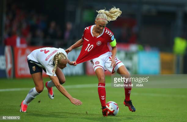 Maria Thorisdottir of Norway Women pulls on the shirt of Permille Harder of Denmark Women during the UEFA Women's Euro 2017 match between Norway and...