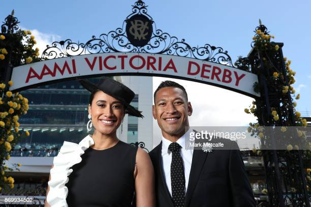 Maria Tutaia and Israel Folau pose on AAMI Victoria Derby Day at Flemington Racecourse on November 4 2017 in Melbourne Australia