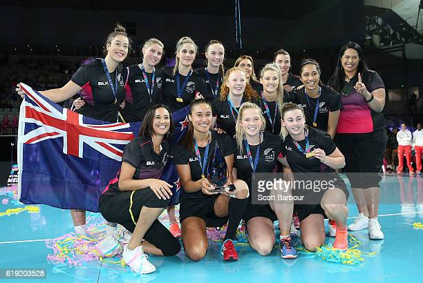 Maria Tutaia captain of New Zealand and her teammates celebrate with the trophy after winning the Grand Final of the Fast5 Netball Series between...