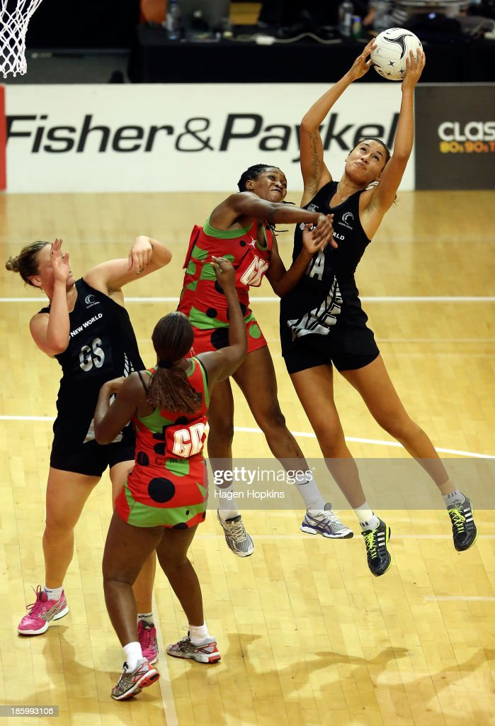 Maria Tutaia of New Zealand receives a pass under pressure from Towela Vinkhumbo of Malawi during the International Test Match between the New Zealand Silver Ferns and the Malawai Queens at Pettigrew Green Arena on October 27, 2013 in Napier, New Zealand.