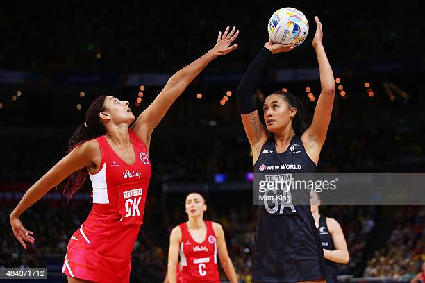 Maria Tutaia of New Zealand shoots as Geva Mentor of England defends during the 2015 Netball World Cup Semi Final 1 match between New Zealand and...