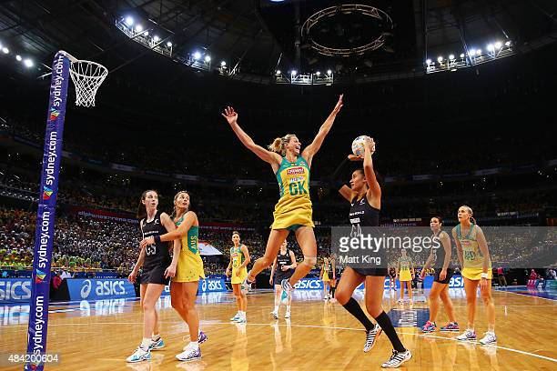 Maria Tutaia of New Zealand shoots as Laura Geitz of the Diamonds defends during the 2015 Netball World Cup Gold Medal match between Australia and...